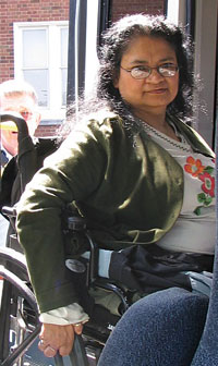 woman boarding the bus in a wheelchair