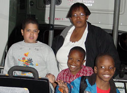 photo of mother with 3 children on bus